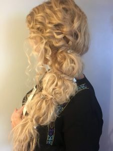 Image of a blonde woman with a plaited wedding hair style.