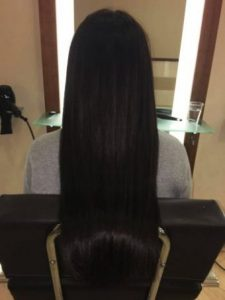 Image of a woman with very long dark brown straightened hair.