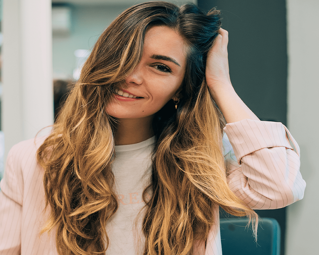 Gallery: Image of a woman with long wavy ombre hair.