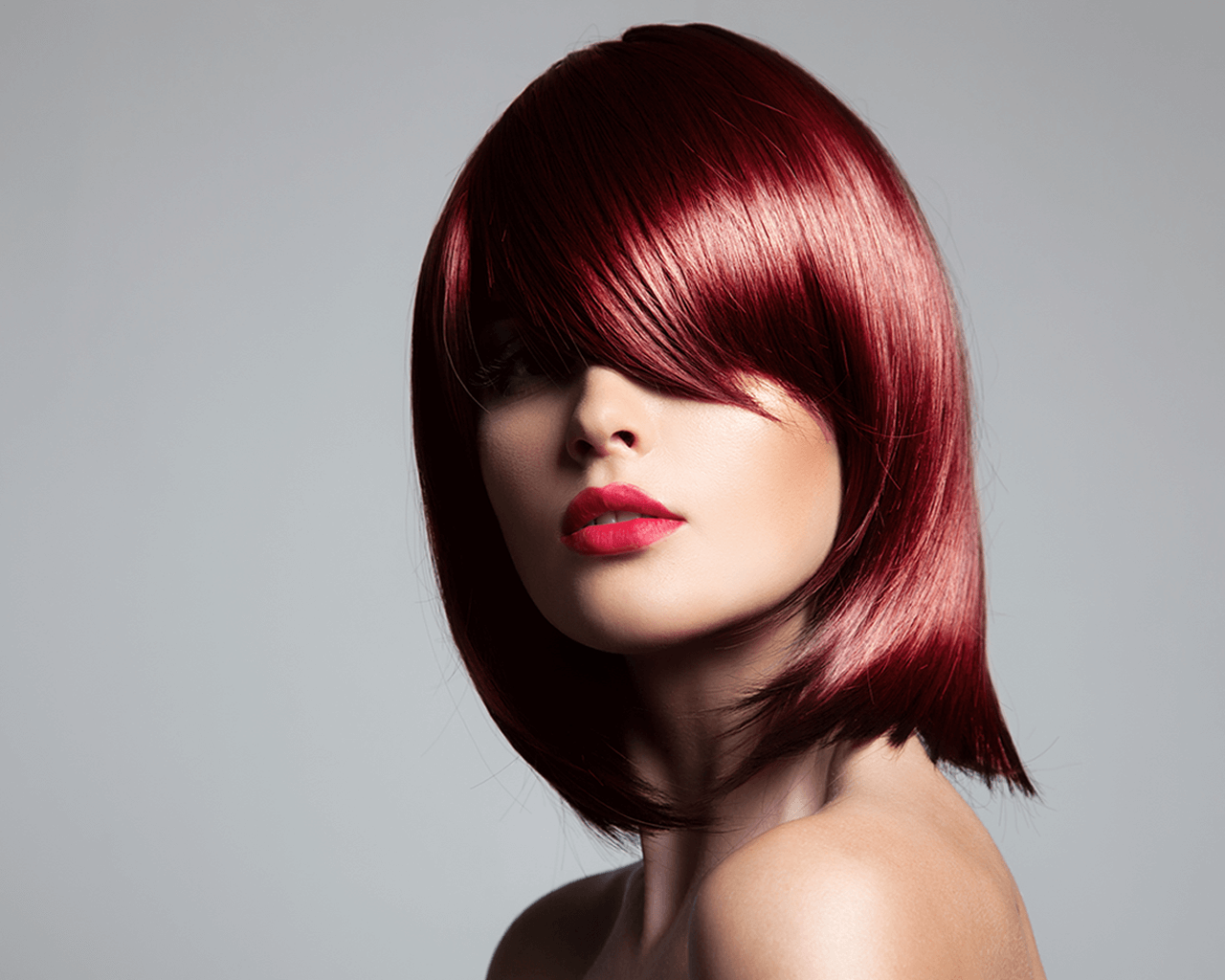 Glossary: Image of a woman with short red hair, in a tapered style.