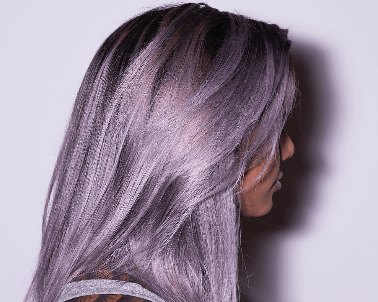Gallery: Image of a woman with layered lilac hair.