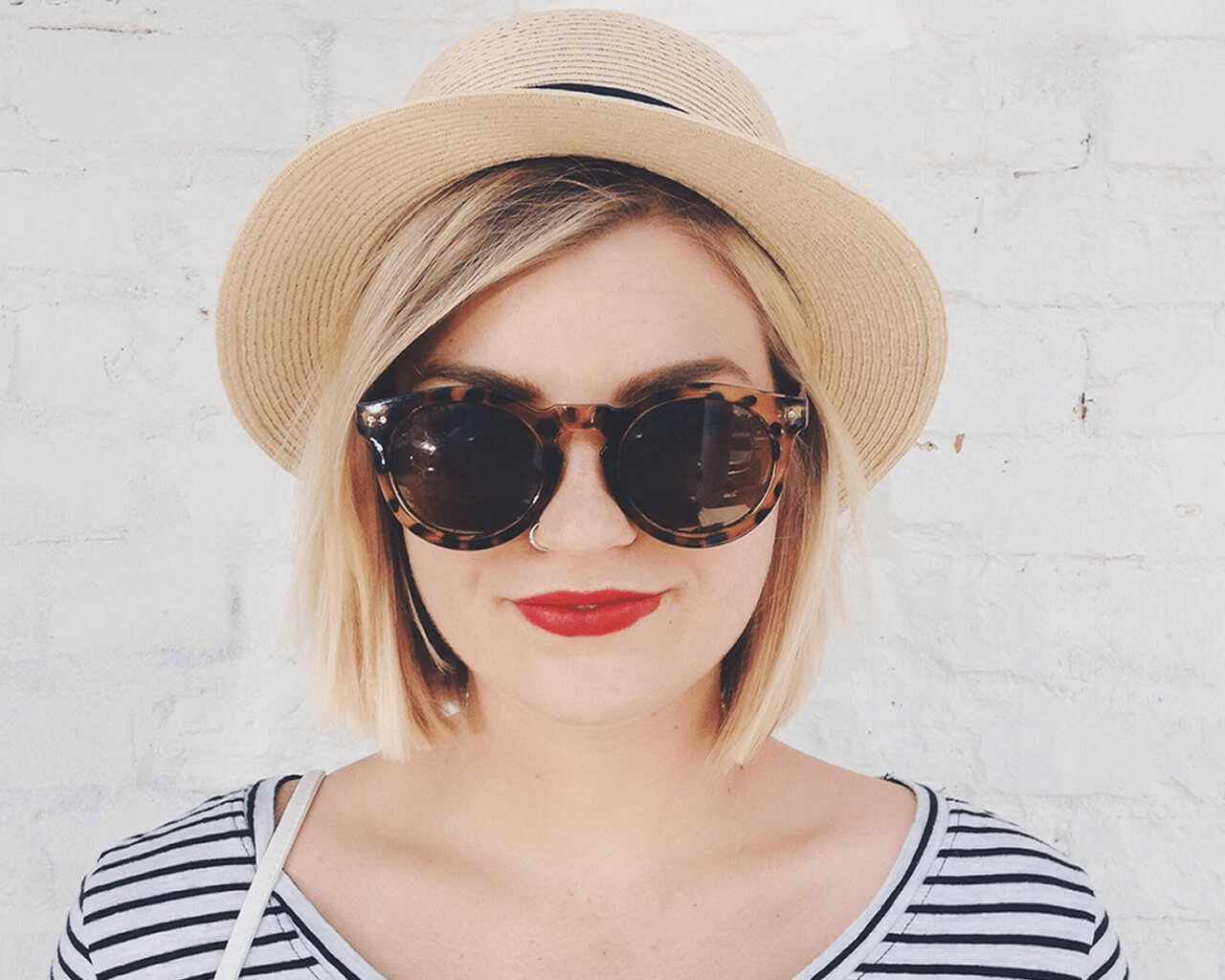 Glossary: Image of a woman with a blonde bob.