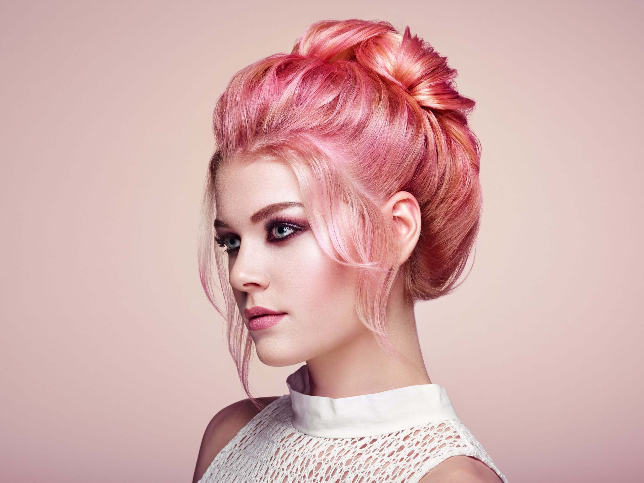 Glossary: Image of a woman with a pink updo.