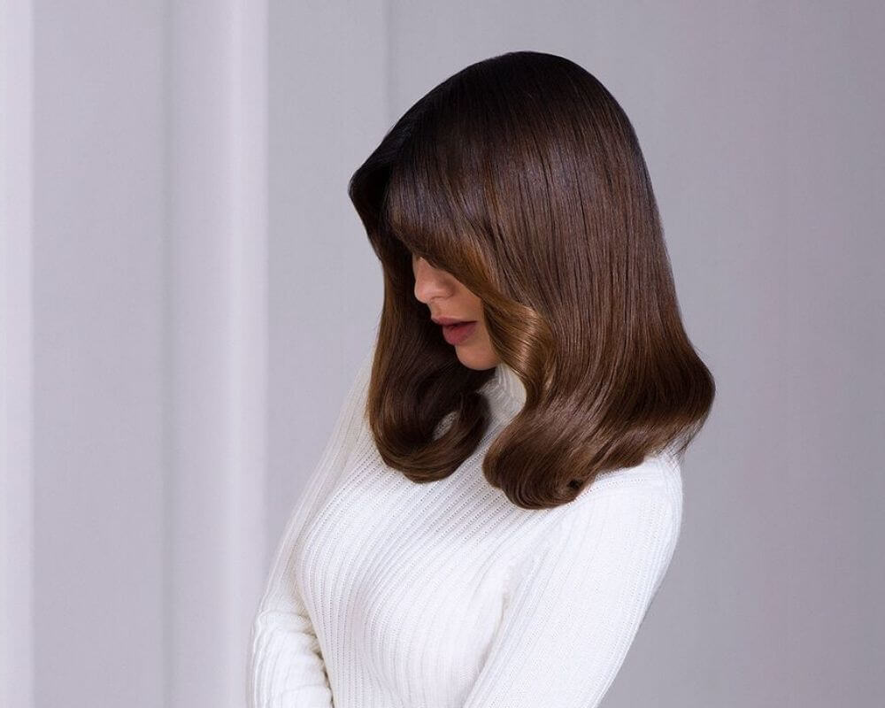 Colour Services: Woman with brunette hair.
