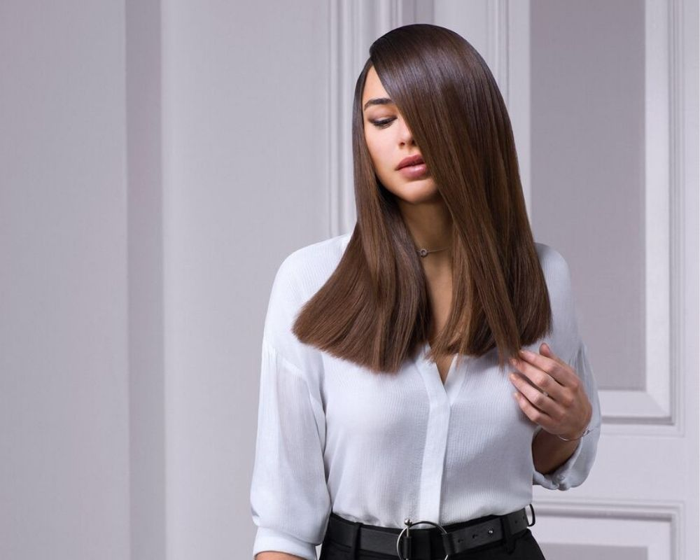 Cut and Blow Dry: Image of a model with a straight, smooth blow dry.