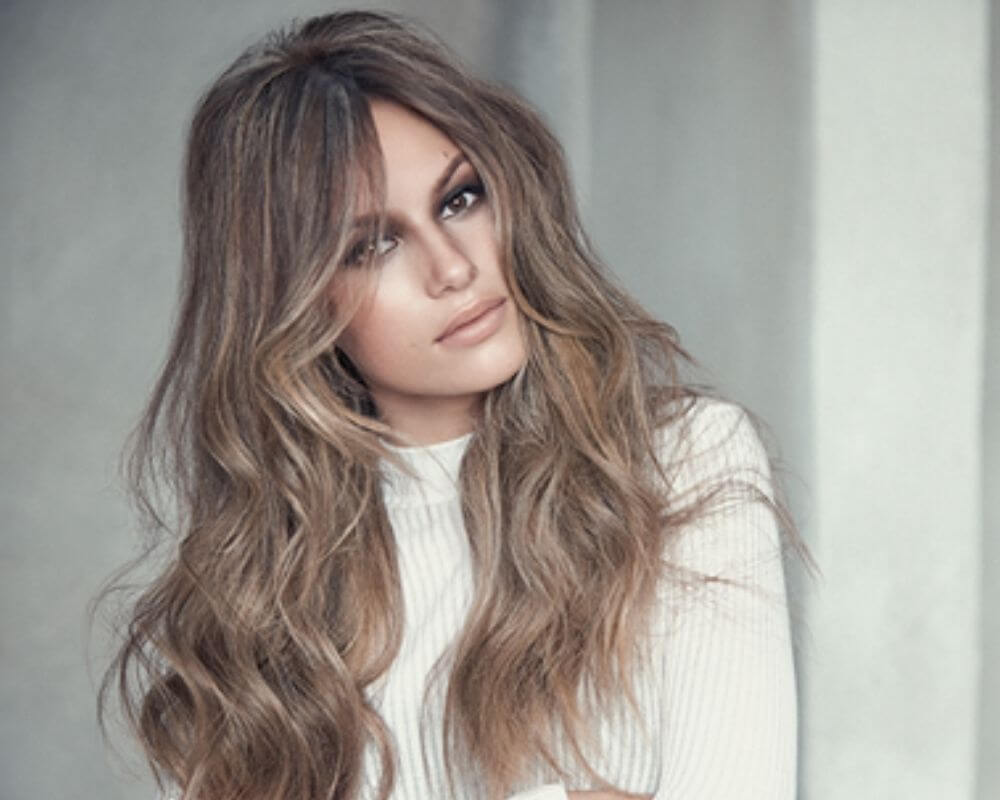 What is Balayage?: Image of a woman with brunette and caramel balayage.