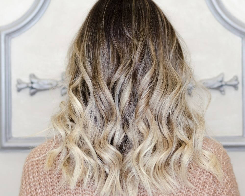What is Ombre: Image of a woman with blonde ombre hair.