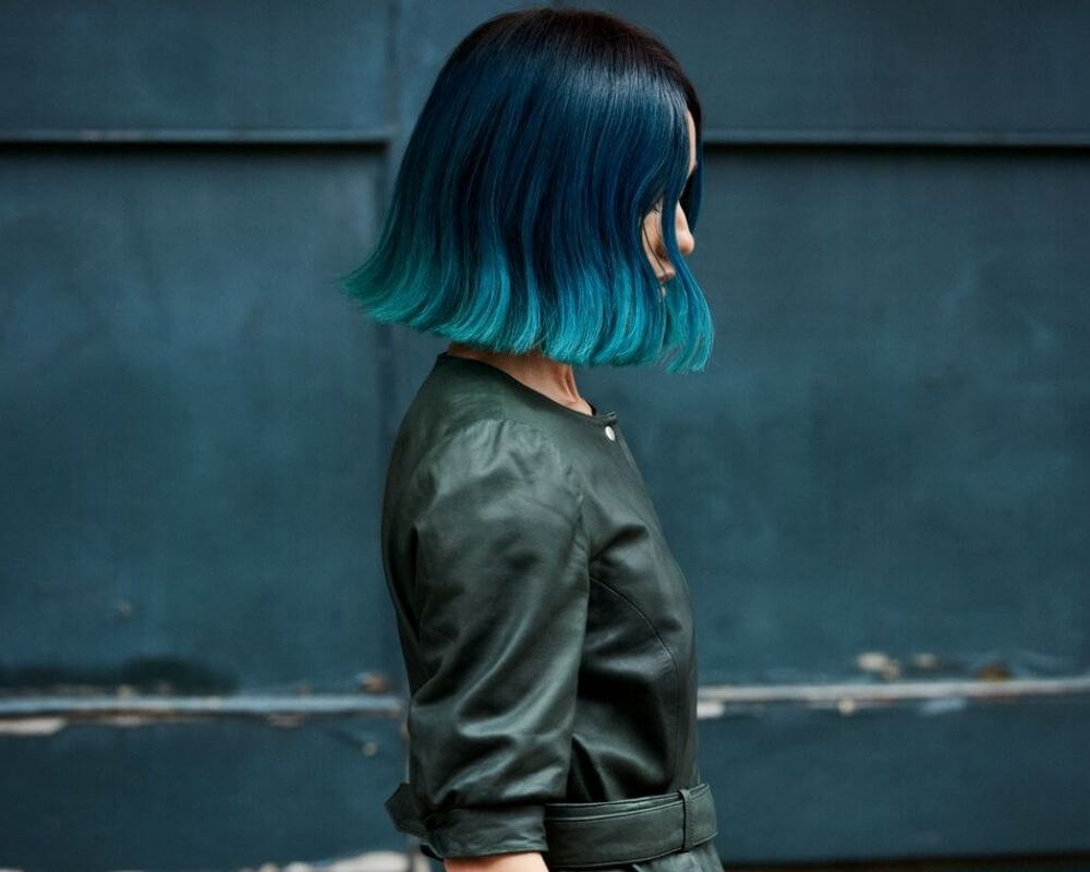 What is Ombre: Image of a woman with blue dip dye ombre hair.