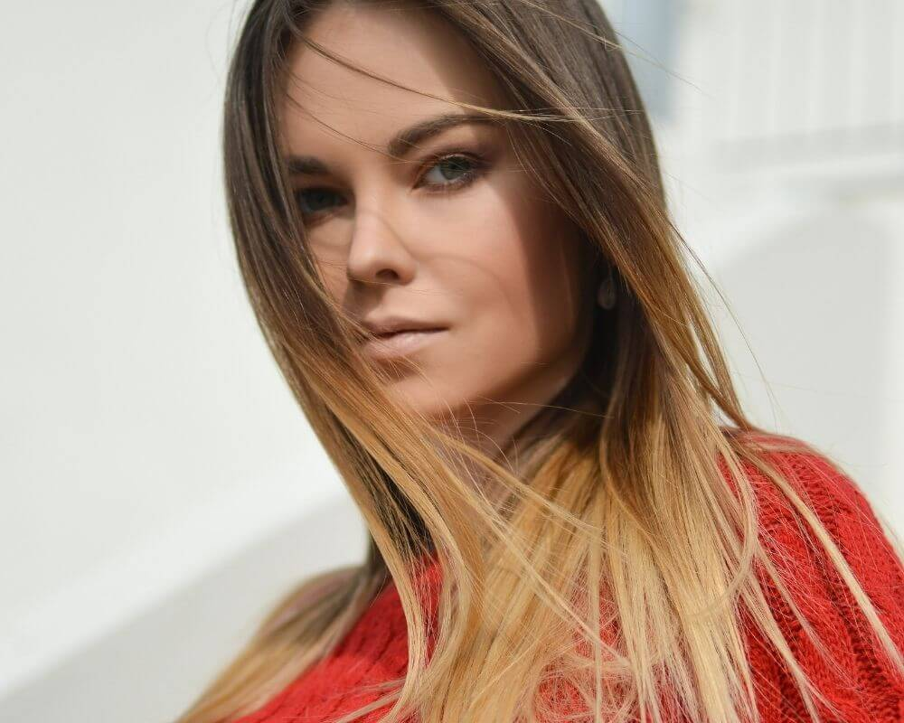 What is Ombre: Image of a woman with caramel ombre hair.